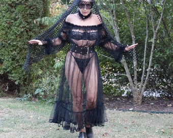 black pvc corset jacket and fire cape chariot tribute parade
