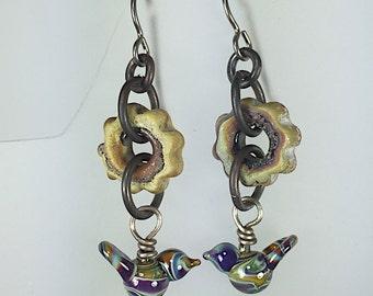 Earrings by Thornburg Bead Studio - handmade glass gears and birds