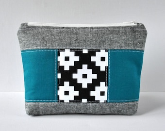 Woman's linen patchwork beauty bag padded travel black modern cross and teal blue block print cosmetics quilted make up pouch.