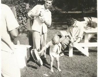 "Vintage Snapshot ""Men At Work"" Handsome Man Wine Bottle Picnic Table Out Of Frame Found Vernacular Photo"