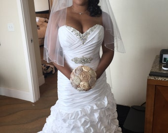 Rosette champagne and ivory wedding bouquet. Rolled satin fabric roses.
