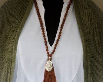 Rudraksha Necklace with Sterling Silver Narasimha Cotton Tassel and Brass Spacers NEC0005