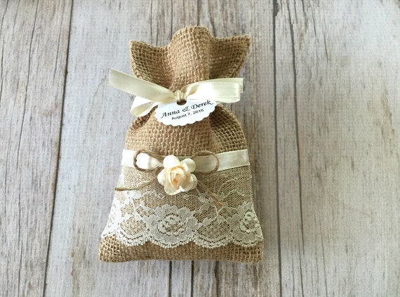 ... favor bags with personazlied tags and ivory flowers, wedding, bridal