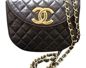 Reserved for Nicole. 80's Vintage CHANEL black quilted lambskin shoulder purse with large golden CC oval flap and chain strap.