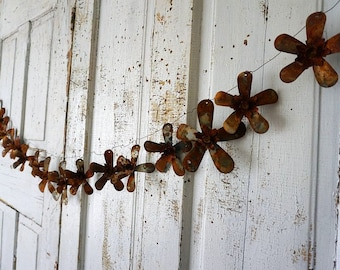 """Rusty metal flower garland wall hanging rustic farmhouse heavily oxidized colors 63"""" long w/ several sized flowers  decor anita spero design"""
