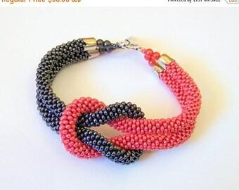15% SALE Beadwork - Bead Crochet Bracelet in grey and red - Beaded Bracelet - Infinity Knot Bracelet - Beaded Bracelet Cuff