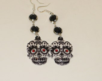 Day of the Dead skull with glass beads and chain earrings.