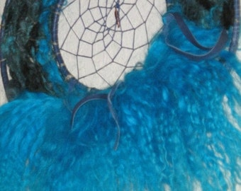 Mongolian Lamb fur Dreamcatcher,Mandela weaved in Turquoise,hand dyed spun yarns in deep blues,hemp blue cording,feather totem charm dangles