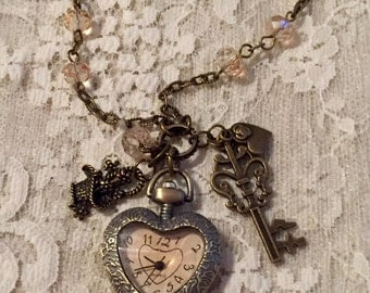 Small Heart Shaped, Pocket Watch Necklace.  Antique Bronze Tone With Amber Glass Face.