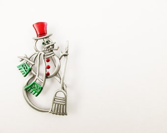 """A 'JJ' Snowman - Bold See-through 3"""" Tall Snowman - Pewter Look  Holiday Brooch With Green Rhinestone Eyes - Jewelry From the 70s"""