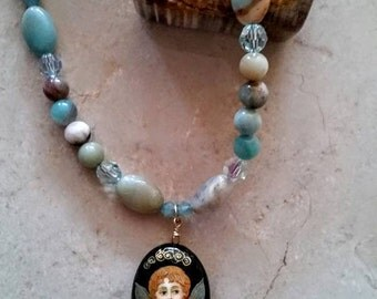 Handcrafted black gold amazonite necklace with Swarovski crystals and a hand-painted cherub pendant