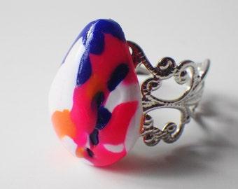 Hot pink teardrop ring on adjustable band
