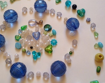 100+ blues, greens, pearlescents and clear vintage beads