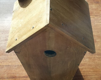 Hand crafted wooden bird house in upcycled wood