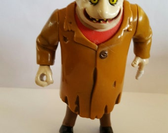 Vintage 1992 Playmates Toys Addams Family Uncle Fester plastic action figure.