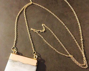 White Crystal Pendant Embossed with Gold on a Long Gold Chain Necklace