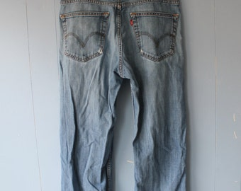 Vintage High Waisted Levis/Red Tab/ Distressed/Faded/Super Soft/Boyfriend Jeans