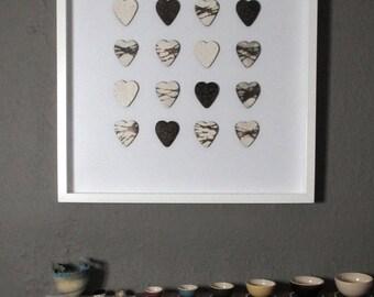 Sixteen smoke fired hearts - framed
