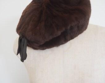 Vintage 50's beaver fur winter beret with satin bow detail.