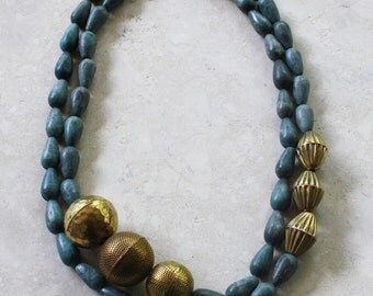 Matte blue magnetite and brass necklace