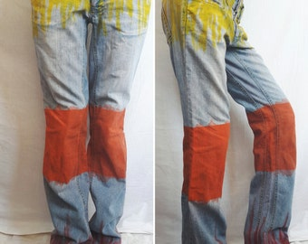 Hand painted jeans with low waist. Straight jeans painted in yellow, orange and red.