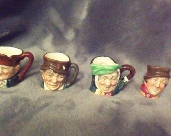 Royal Doulton mini's, Old Charlie, Paddy, Sairey Gamp, and Sam Weller