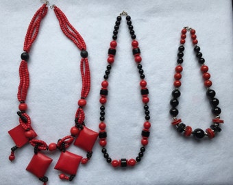 Three red and black beaded necklaces