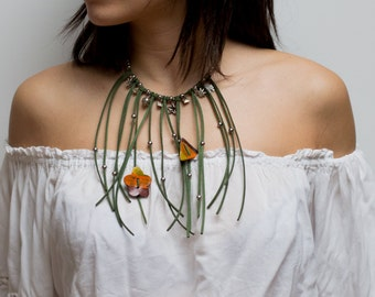 In and green suede necklace