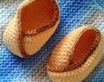 Crocheted yellow cotton worsted booties