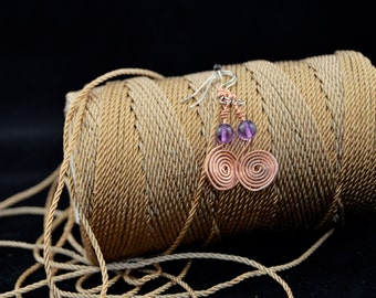 Infinity swirl copper earrings with amethyst beads