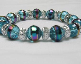 Beautiful handmade Aqua glass bead stretch bracelet.