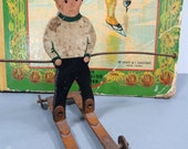 Antique Folk Art Wood Pull Toy, Little Boy on Metal Skis with Metal Wheels, Winter, Christmas Decor, Skier Collectible