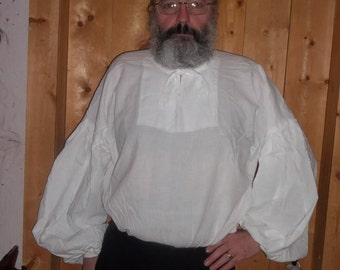 Plus size white Elizabethan shirt with ties at the neck and cuffs.