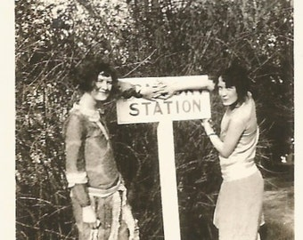 """Vintage Photo """"Misdirection"""" Two Flappers Cover Up Part Of A Road Sign - Small Found Vernacular Photo"""