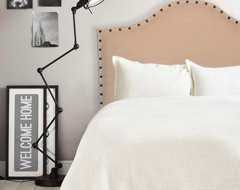 Upholstered linen headboard with nail trim, Mary.