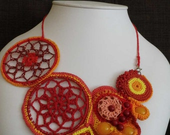 A crochet necklace with agate and coral beads