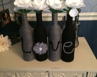 Black and Grey Wine Bottles that spell Love with Flowers