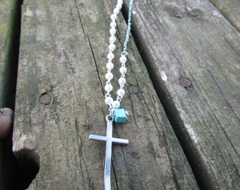 Turqouise and a silver plated cross sweet