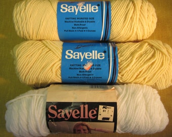3 skeins Sayelle orlon acrylic yarn, 2 gold mist, pale yellow, 1 white, 4 ply worsted weight, 10 oz total