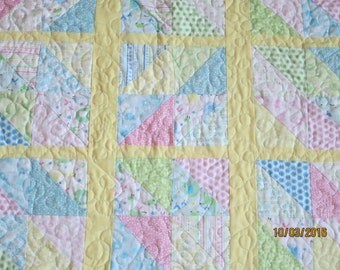 Baby's small QUILT 36 inches X 33 inches    yellow backing with pastel baby colors