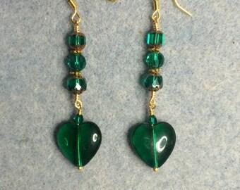 Emerald green Czech glass heart bead dangle earrings adorned with emerald green Czech glass beads.