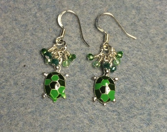 Small green enamel turtle charm dangle earrings adorned with tiny green Chinese crystal beads.