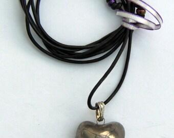 Small silver pendant.