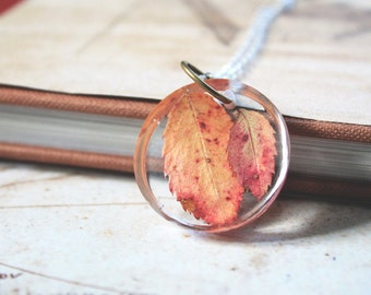 Round Resin pendant with two real red leaves