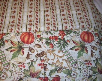 "2 pieces of fall fabric  ""falling leaves"" one has just leaves and the other pumpkins leaves acorns  1 yard 15"""