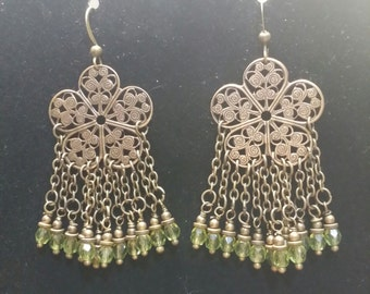 Brass chandelier earrings with olive green crystals