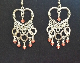 Silver chandelier earrings with rich, pink crystals
