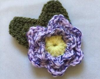 Purple crochet flower brooch