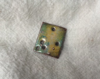 hand torched enamel over copper charm/jewelry component. 17mm x 20mm
