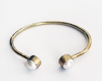Brass open bracelet with two pearls